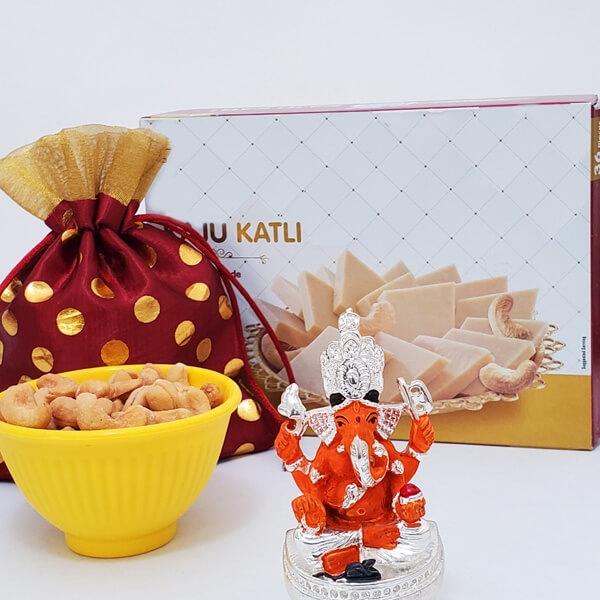 Sitting Ganesha with Kaju Katli and Nuts